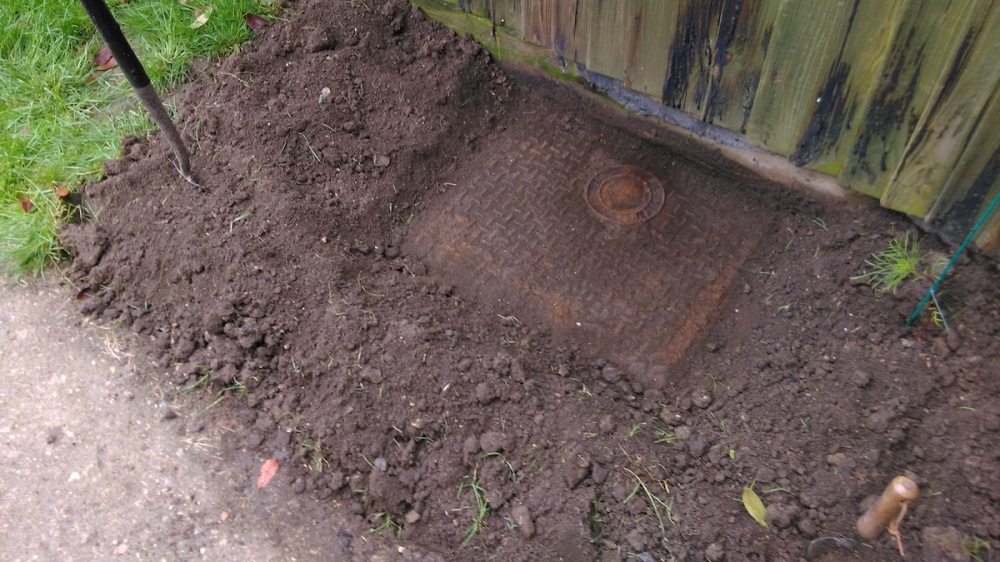 Finding a buried manhole cover.