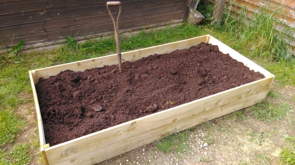 Two Homebase raised beds stacked on top of each other and filled with soil.