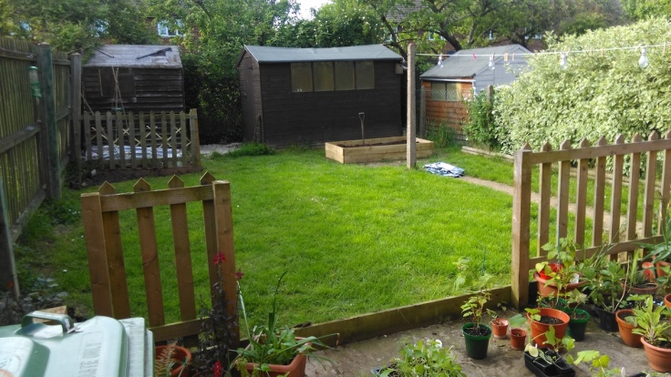 A lawn garden with sheds awaiting planting