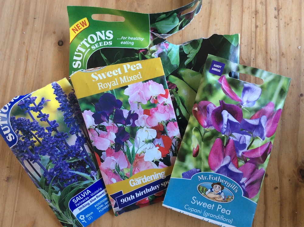 packets of sweet pea, salvia, and broad bean seeds